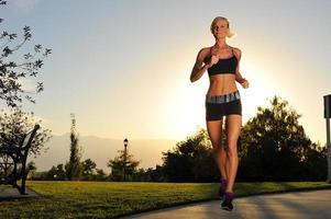 Athletic woman running in the park photo