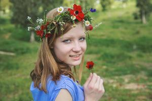 Teen girl on spring meadow photo