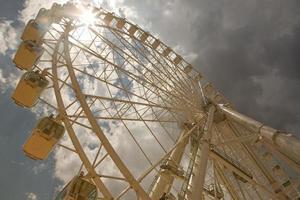 Ferris wheel over cloudy sky photo