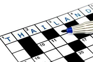 Thailand in solving crossword puzzle, close up photo
