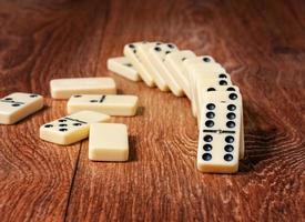 domino pieces on the brown wooden table background photo