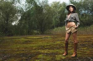 safari woman in  the morning swamp photo