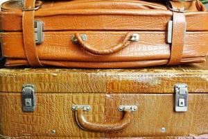 Vintage shabby old suitcase yellow photo