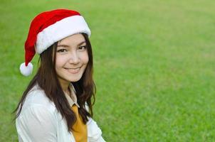 Beautiful young santa clause woman