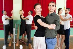Positive adults enjoying of classical dance photo