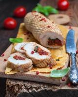 roulade of chicken breast with basil, sage and dried tomatoes
