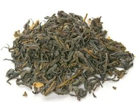 Dry green tea leaves on white background.
