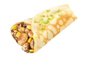 Crepe stuffed with mushrroms and corn