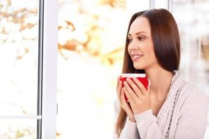 Attractive young lady holding a cup photo
