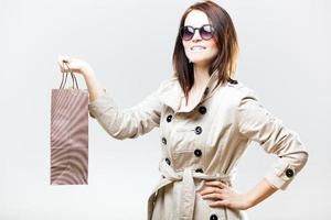 Portrait of stylish woman with shopping bag