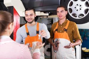 Mechanics and happy customer photo