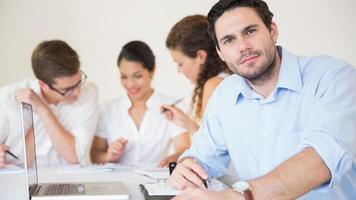 Confident businessman in meeting room photo