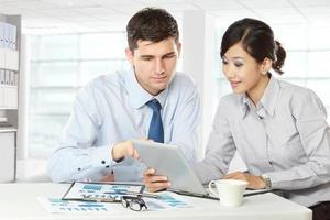 business partners using touchpad at meeting photo