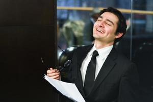 Satisfied businessman at the end of a meeting photo