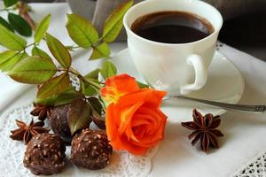 Morning coffee, rose and candy.