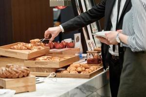 Tasty and sweet croissants at the buffet restaurant photo