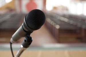 Microphone on stage of conference hall photo