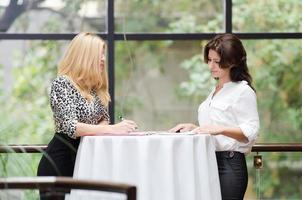 Two business women talking in a cafe photo