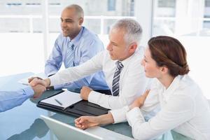 Businessman shaking hand during work interview photo