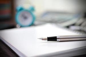 caneta e caderno