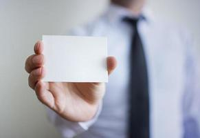Man's hand showing blank card