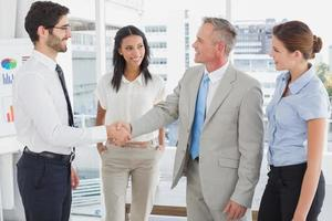Business man shaking colleagues hand