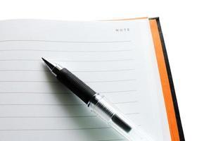caneta e caderno foto