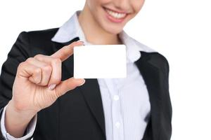 Showing sign - business card woman