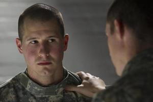 Soldier being consoled by his peer, horizontal photo