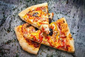 Pizza cut into slices photo