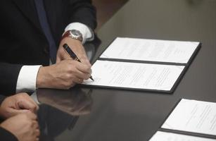 signature signing contract office business photo