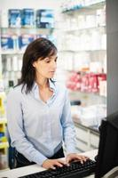 The pharmacist resolves all doubts of his client photo
