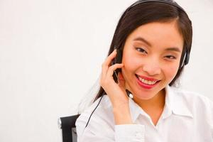 Close-up of a young smiling female customer service executive photo