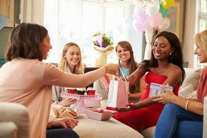 Group Of Female Friends Meeting For Baby Shower At Home photo