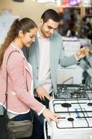 Couple choosing kitchen stove
