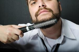Hipster combing his beard