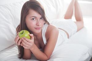 Beautiful young girl with apple photo
