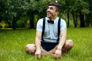Satisfied smiling young male outdoors