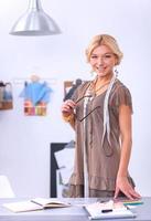 Modern young fashion designer working at studio.