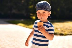 Boy eating icecream photo