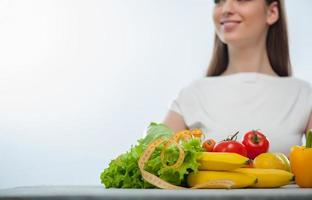 Pretty girl is standing near healthy food photo