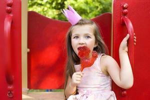 Princess licking a lollipop