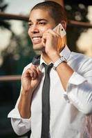 Successful businessman talking on mobile and smiling photo