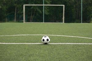 Classic ball for playing soccer on sports ground photo