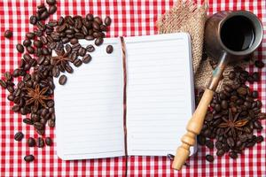 Blank paper, coffe bean and coffee cup on wood