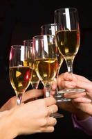 People hands with crystal glasses full of champagne