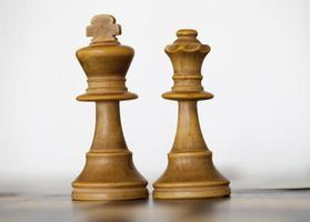 Wooden white king and queen chess pieces