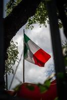 Italian flag agains the sun photo