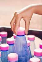 Choosing a bottle of drink water.