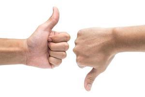 Thumb up and thumb down hand signs photo